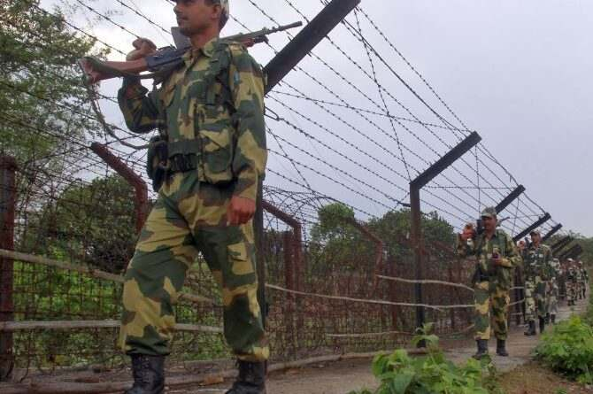 India's Border Security Force (BSF) soldiers patrol along the fencing of the India-Bangladesh international border ahead of the general election on the outskirts of Agartala, capital of India's northeastern state of Tripura April 4, 2014. India, the world's largest democracy, will hold its general election in nine stages staggered between April 7 and May 12. REUTERS/Jayanta Dey (INDIA - Tags: ELECTIONS POLITICS MILITARY) - RTR3JY7M