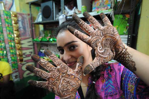 Girls show designs of mehndi on their palms ahead of Karva Chauth in on  Monday.Tribune Photo:Inderjeet Singh