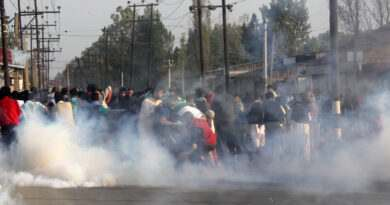kashmir-people-carrying-the-body-of-11-year-old-junaid-amid-tear-gas-shells-fired-by-police-during-funeral-procession-who-was-killed-in-forces-action-during-fresh-clashes-in-srinagar-umar-ganie-09