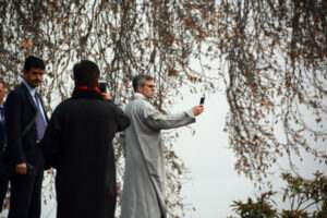 Omar Abdullah busy taking selfie at 111th birth anniversary of grandfather sheikh mohammad abdullah in hazratbal area on the bank of Dal Lake