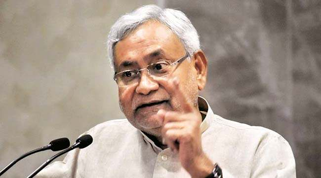 Patna: Bihar Chief Minister Nitish Kumar addressing at a function for the inauguration of developmental schemes of Department of Energy in Patna on Thursday. PTI Photo  (PTI5_11_2017_000111A)