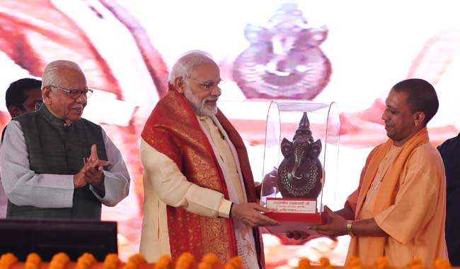 The Prime Minister, Shri Narendra Modi at the foundation stone laying ceremony of Poorvanchal Expressway, in Azamgarh, Uttar Pradesh on July 14, 2018. The Governor of Uttar Pradesh, Shri Ram Naik and the Chief Minister of Uttar Pradesh, Yogi Adityanath are also seen.